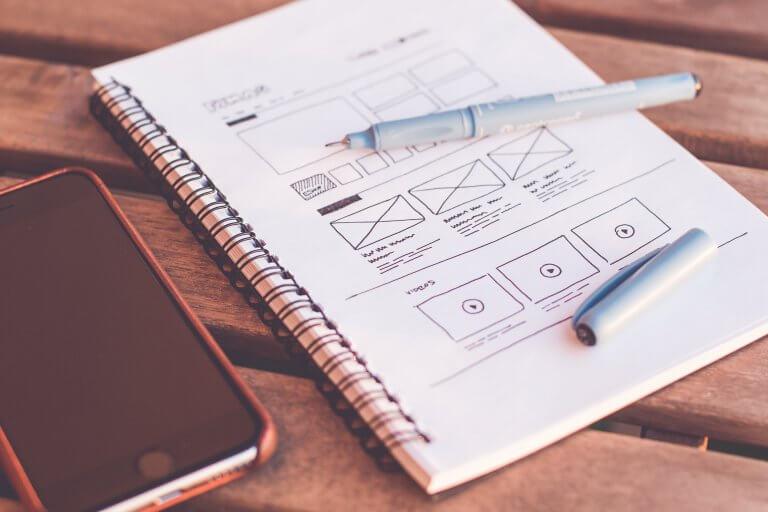 website design notes on a notebook