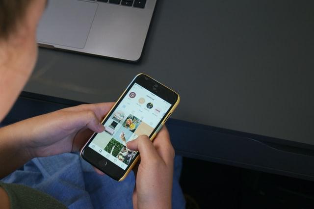 Guy Using Instagram App
